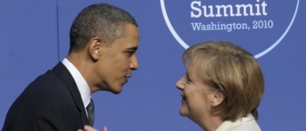 President Barack Obama greets German Chancellor Angela Merkel during the official arrivals for the Nuclear Security Summit in Washington, Monday, April 12, 2010. (AP Photo/Susan Walsh)
