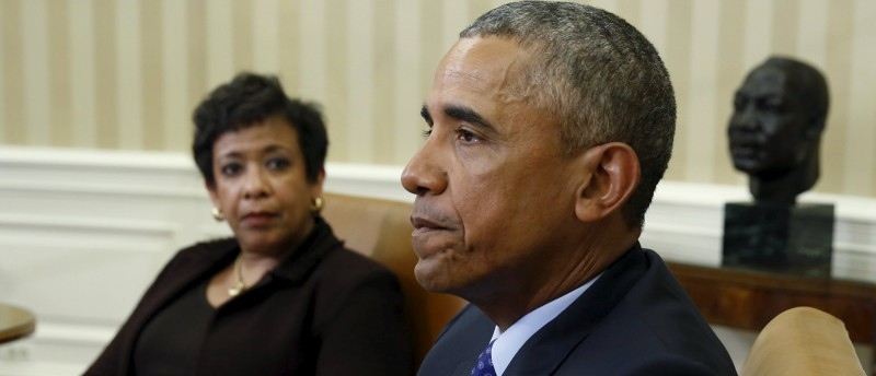 U.S. Attorney General Lynch looks toward U.S. President Obama during a meeting with other top law enforcement officials to discuss what executive actions he can take to curb gun violence, in the Oval Office of the White House in Washington