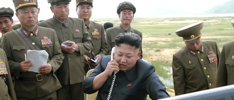 North Korean leader Kim Jung Un guides the test fire of a tactical rocket in this undated photo released by North Korea's Korean Central News Agency (KCNA) in Pyongyang August 15, 2014. REUTERS/KCNA/Files