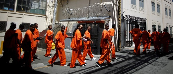 Inmates walk in San Quentin state prison in San Quentin, California, in this June 8, 2012 file photo. c