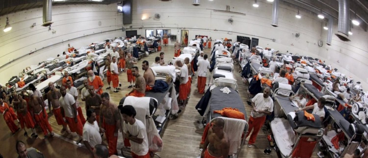 Inmates walk around a gymnasium where they are housed due to overcrowding at the California Institution for Men state prison in Chino, California, in this June 3, 2011 file photo. REUTERS/Lucy Nicholson/Files