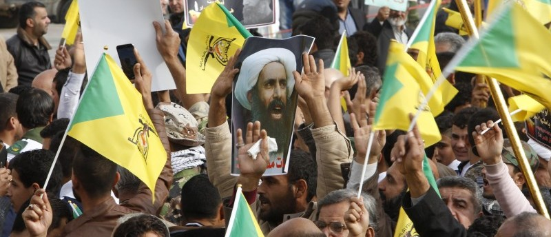 Shi'ites protest against the execution of Shi'ite Muslim cleric Nimr al-Nimr in Saudi Arabia, during a demonstration in Baghdad