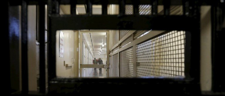 Members of the media walk down the corridor inside the Adjustment Center during a media tour of California's Death Row at San Quentin State Prison in San Quentin, California
