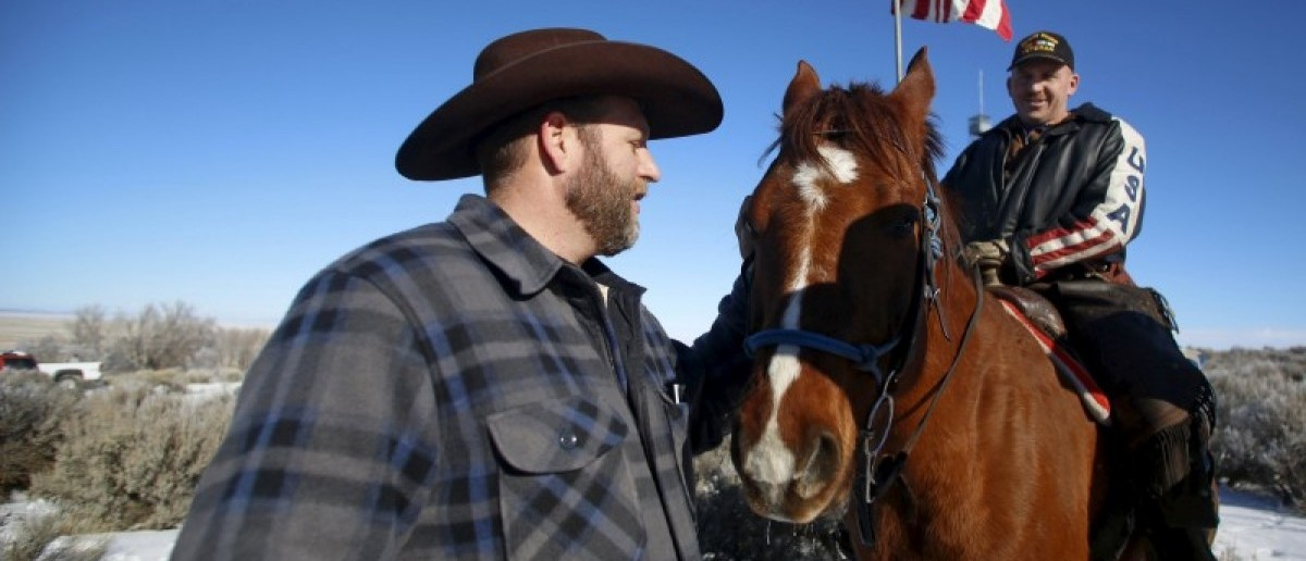 Leader of a group of armed protesters Ammon Bundy (L) greets occupier Duane Ehmer and his horse Hellboy at the Malheur National Wildlife Refuge near Burns, Oregon, January 8, 2016. REUTERS/Jim Urquhart