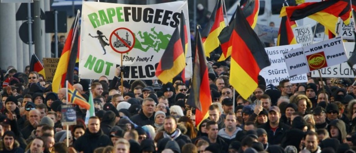 Supporters of anti-immigration right-wing movement PEGIDA (Patriotic Europeans Against the Islamisation of the West) take part in in demonstration rally, in reaction to mass assaults on women on New Year's Eve, in Cologne, Germany, January 9, 2016.   REUTERS/Wolfgang Rattay