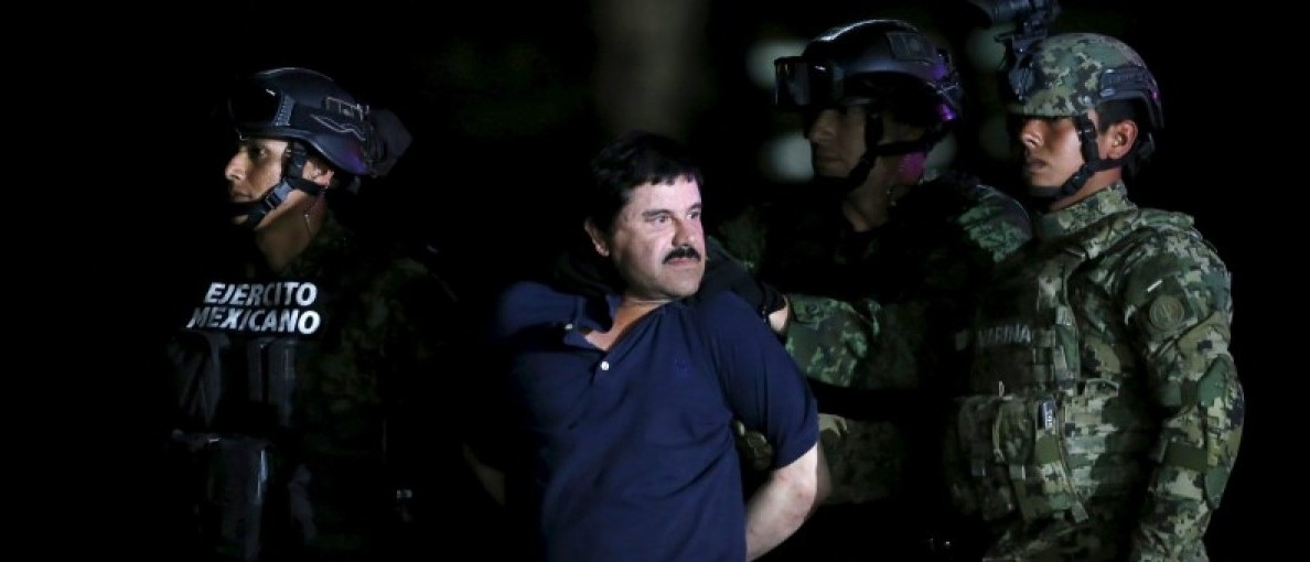 "Joaquin ""El Chapo"" Guzman is escorted by soldiers during a presentation at the hangar belonging to the office of the Attorney General in Mexico City, Mexico January 8, 2016.  REUTERS/Edgard Garrido"