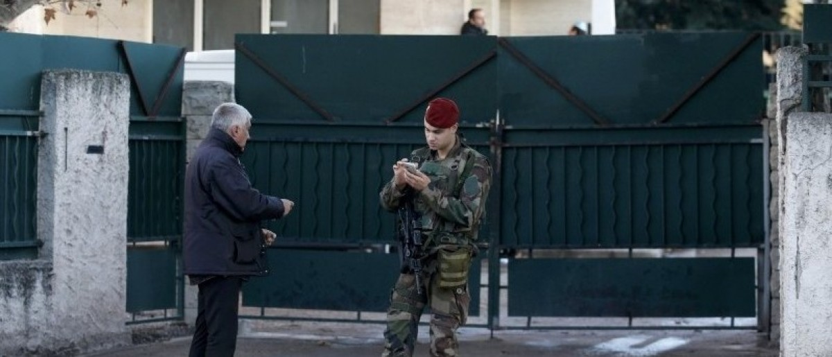A French soldier secures the access to a Jewish school in Marseille 9th district, France, January 11, 2016 after a teenager, armed with a machete and a knife, wounded a teacher slightly before being stopped and arrested. The teenager who attacked a Jewish teacher in Marseille on Monday is a Turkish citizen of Kurdish origin who said he acted in the name of the militant Islamist group Islamic State, the prosecutor in the southern French city of Marseille said.