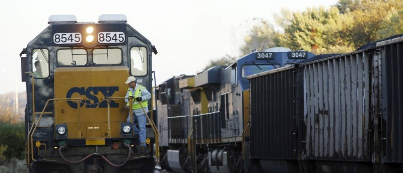 File photo of a CSX coal train moving past an idling CSX engine at the switchyard in Brunswick