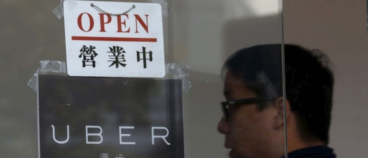 An open sign is seen at the office of taxi-hailing service Uber Inc during a driver recruitment event in Hong Kong, China December 29, 2015. REUTERS/Tyrone Siu