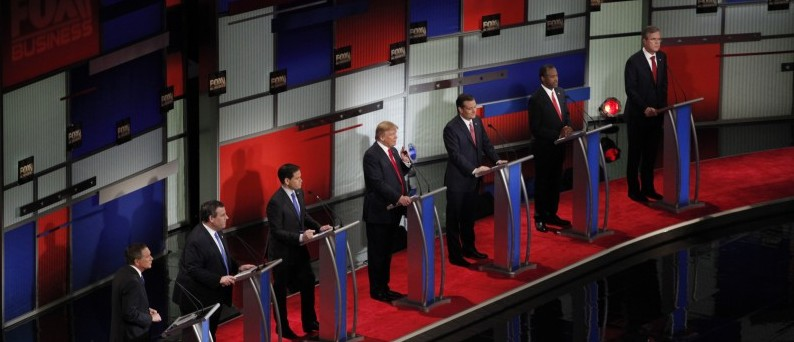 Republican U.S. presidential candidate businessman Donald Trump speaks as he stands amongst six rivals for the Republican presidential nomination during the Fox Business Network Republican presidential candidates debate in North Charleston, South Carolina January 14, 2016. REUTERS/Randall Hill