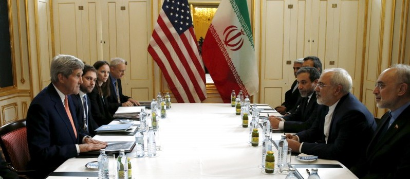 "U.S. Secretary of State John Kerry (L) meets with Iranian Foreign Minister Mohammad Javad Zarif on what is expected to be ""implementation day,"" the day the International Atomic Energy Agency (IAEA) verifies that Iran has met all conditions under the nuclear deal, in Vienna January 16, 2016.  REUTERS/Kevin Lamarque"