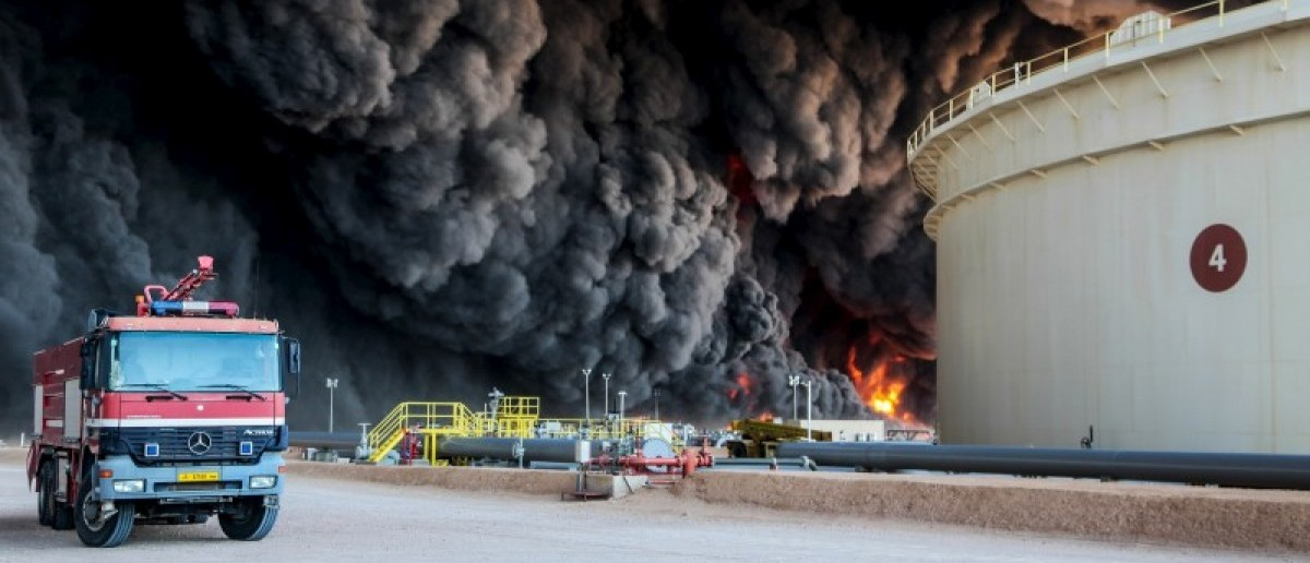 Fire rises from an oil tank in the port of Es Sider, in Ras Lanuf, Libya, January 6, 2016. (REUTERS/Stringer)