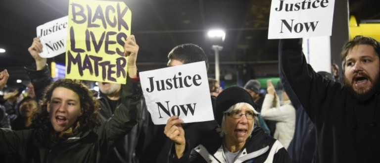 Black Lives Matter protesters chant slogans at the Mall of America light rail station in Bloomington, Minnesota December 23, 2015. REUTERS/Craig Lassig
