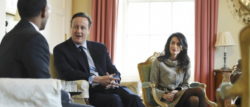 Lawyer Amal Clooney sits with Britain's Prime Minister David Cameron and the former Maldives President Mohamed Nasheed in 10 Downing Street, in London