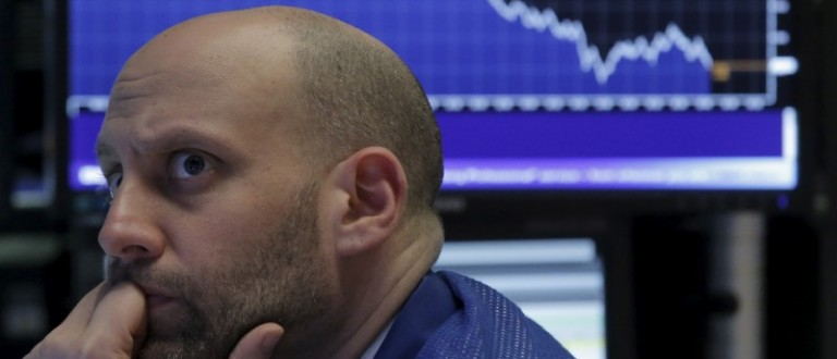 Specialist trader Meric Greenbaum works at his post on the floor of the New York Stock Exchange