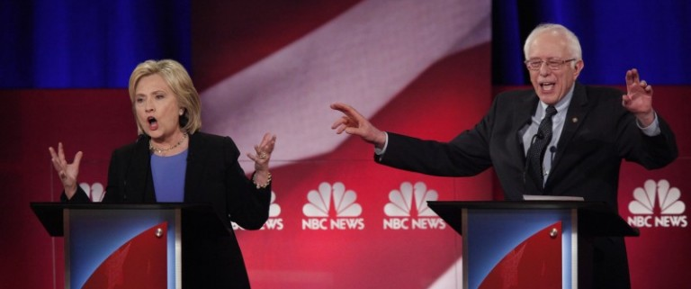 Democratic U.S. presidential candidate and former Secretary of State Hillary Clinton and rival candidate U.S. Senator Bernie Sanders speak simultaneously at the NBC News - YouTube Democratic presidential candidates debate in Charleston