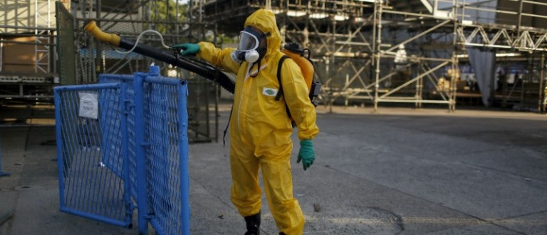 A municipal worker sprays insecticide at Sambodrome in Rio de Janeiro