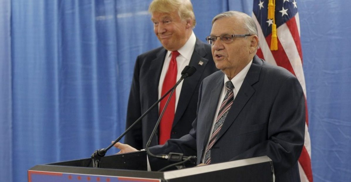 U.S. Republican presidential candidate Donald Trump (L) listens to the endorsement of Maricopa County Sheriff Joe Arpaio before a campaign rally in Marshalltown, Iowa January 26, 2016. REUTERS/Brian Snyder