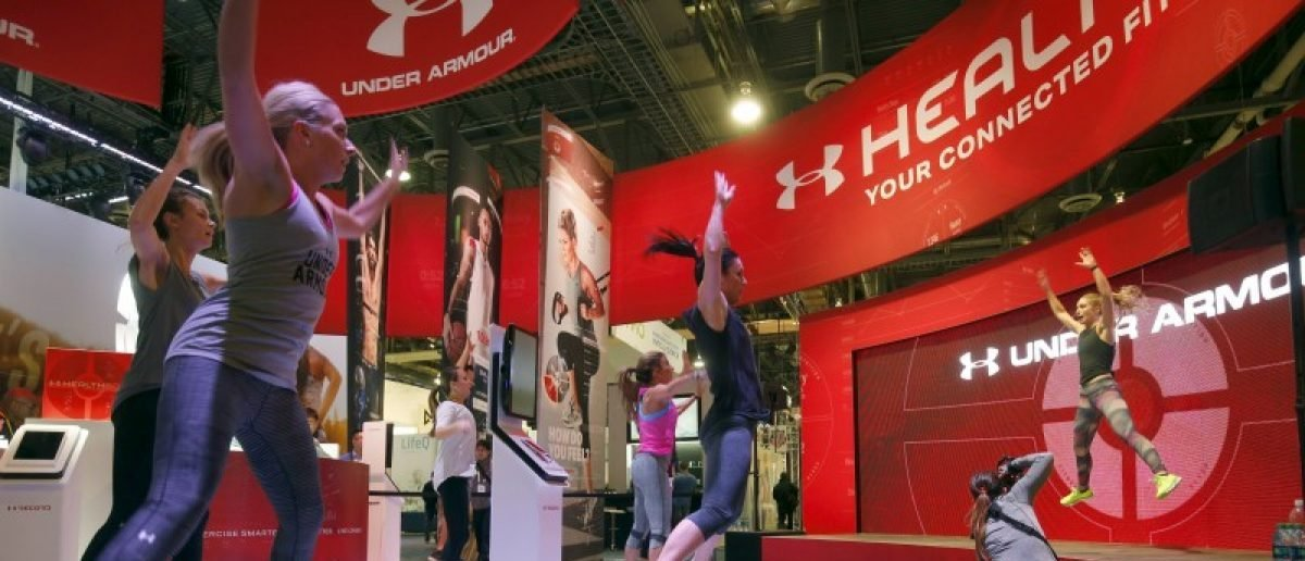 People work out at the Under Armour booth as the company promotes the Health Box, a Connected Fitness system, during the 2016 CES trade show in Las Vegas, Nevada January 8, 2016. REUTERS/Steve Marcus