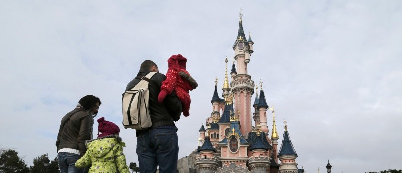 File picture shows visitors walking towards the Sleeping Beauty Castle during a visit to the Disneyland Paris Resort
