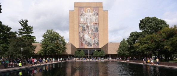 "SOUTH BEND, IN - AUGUST 30:  The mural at the Hesburgh Library, commonly known as ""Touchdown Jesus"" is seen on the campus of Notre Dame University before a game between the Norte Dame Fighting Irish and the Rice Owls at Notre Dame Stadium on August 30, 2014 in South Bend, Indiana.  (Photo by Jonathan Daniel/Getty Images)"
