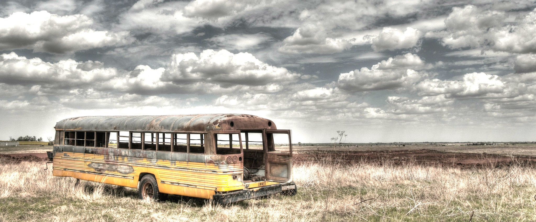 This bus is 'way out in the country by Douglas, OK.... nothing but the Oklahoma wind and the sound of the door swaying. (Flickr photo by mtneer_man https://creativecommons.org/licenses/by-nd/2.0/)