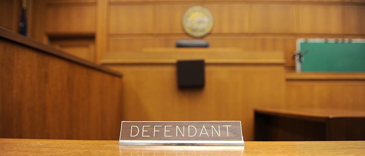 A view of the defendant's table in a courtroom closed due to budget cuts and layoffs, at the Stanley Mosk Courthouse in downtown Los Angeles on March 16, 2009. Beset by an unprecedented budget crisis, the LA Superior Court, the largest trial court system in the US, laid off 329 employees and announced the closure of 17 courtrooms, with more of both expected in the future.       AFP PHOTO/Robyn BECK (Photo credit should read ROBYN BECK/AFP/Getty Images)