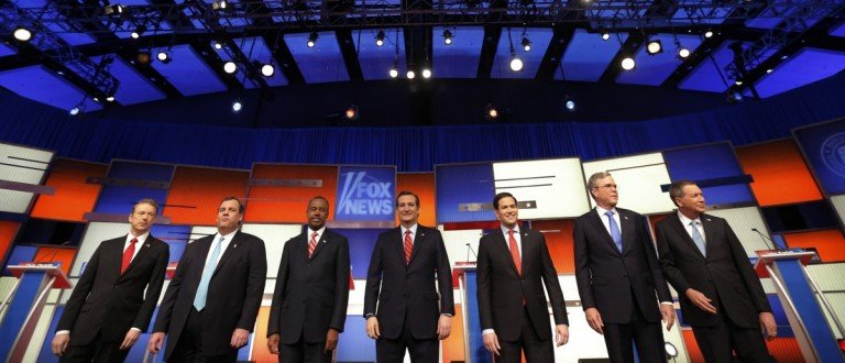 Republican U.S. presidential candidates pose together onstage at the start of the debate held by Fox News for the top 2016 U.S. Republican presidential candidates in Des Moines
