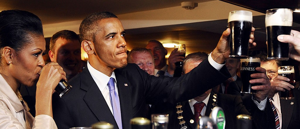 US President Barack Obama (2ndL) and First Lady Michelle Obama (L) sip Guinness at a pub as they visit Moneygall village in rural County Offaly, Ireland, where his great-great-great grandfather Falmouth Kearney hailed from, on May 23, 2011. Obama landed in Ireland on May 23, 2011 for a visit celebrating his ancestral roots, kicking off a four-nation European tour.    AFP PHOTO/ JEWEL SAMAD (Photo credit should read JEWEL SAMAD/AFP/Getty Images)