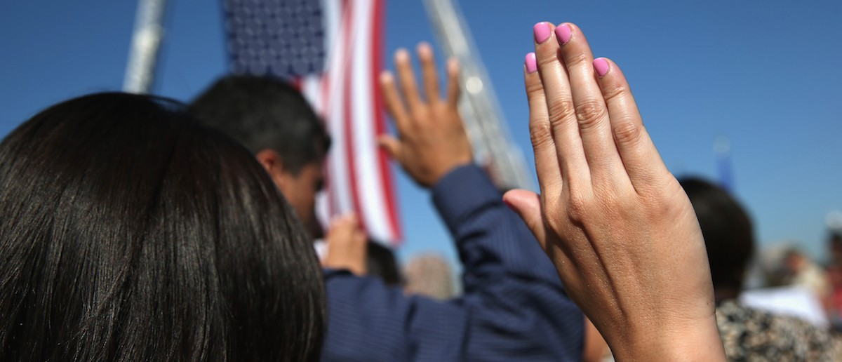 One hundred immigrants become American citizens during a naturalization ceremony at Liberty State Park on September 17, 2015 in Jersey City, New Jersey. (John Moore/Getty Images)