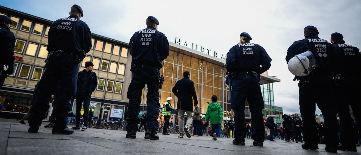 Police stand guard as supporters of Pro NRW, a right-wing, populist group that has campaigned against the construction of new mosques in the German state of North Rhine-Westphalia, protest following the New Year's Eve sex attacks by what witnesses described were gangs of Arab or North African men on January 6, 2015 in Cologne, Germany. (Sascha Schuermann/Getty Images)