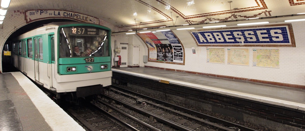 """A picture taken on March 25, 2010 in Paris shows a train running at the """"Abbesses"""" metro station on Line 12 of the Paris Metro in the Montmartre district and the 18th arrondissement. ( JACQUES DEMARTHON/AFP/Getty Images)"""
