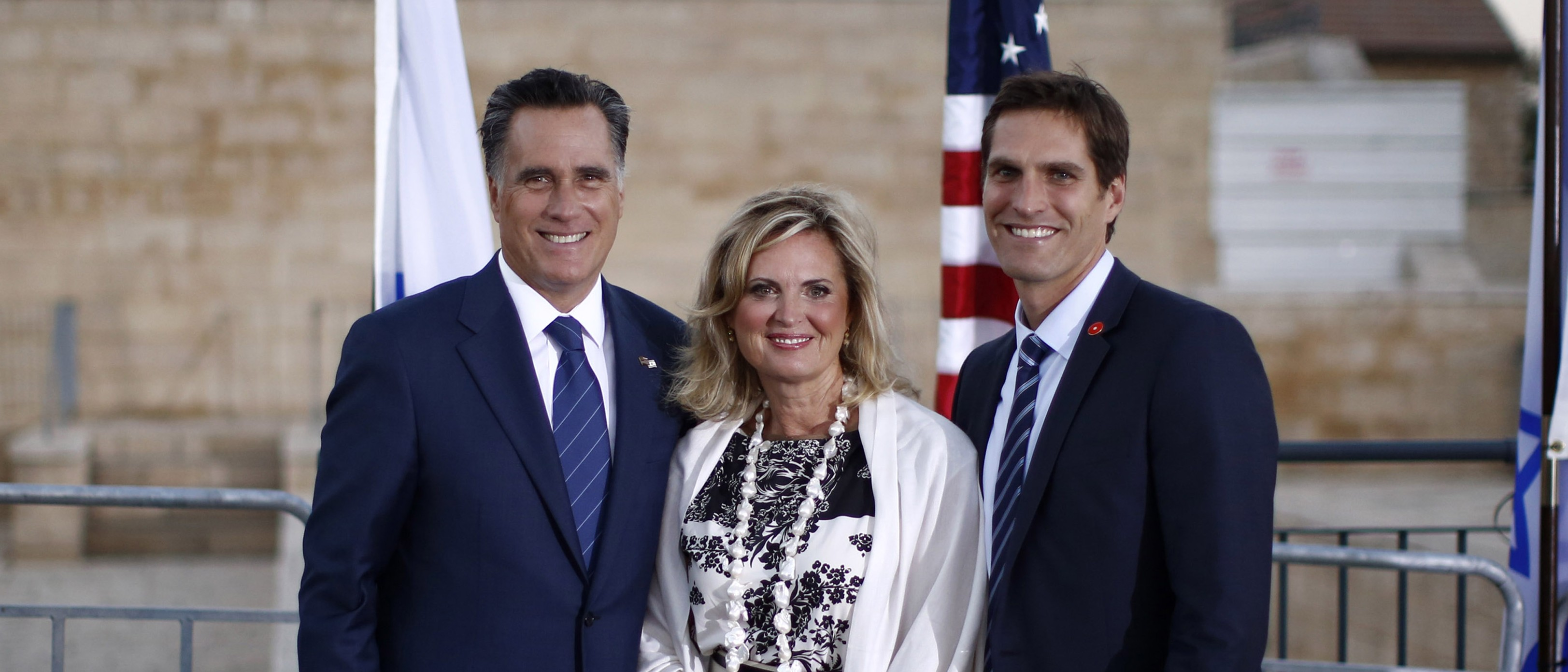 U.S. Republican Presidential candidate Mitt Romney (L) poses with his wife Ann and their son Josh after he delivered foreign policy remarks at Mishkenot Sha'ananim in Jerusalem, July 29, 2012. REUTERS/Jason Reed (JERUSALEM - Tags: POLITICS) - RTR35LKL