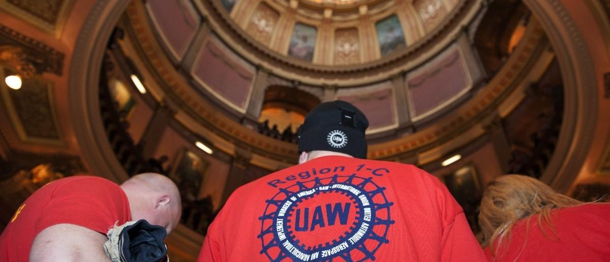 Labor union members (REUTERS/James Fassinger)