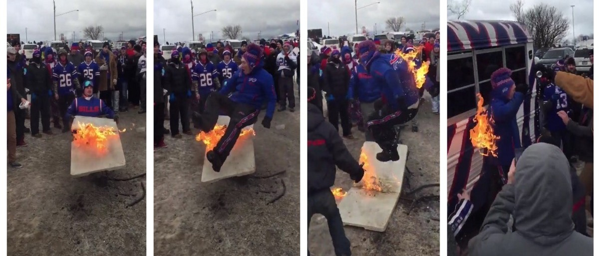 Bills Fan Destroys Flaming Table Because Some Men Just Want To Watch The World Burn (Twitter)