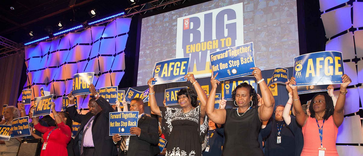 """American Federation of Government Employees display """"Big Enough to Win"""" signs by AFGE Flickr Creative Commons"""