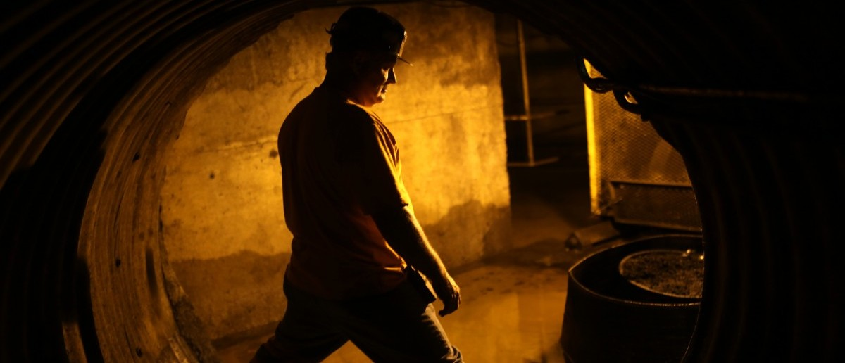 Coal miner Mike Hawks, 53, stands in an underground tunnel at a coal processing facility near Gilbert