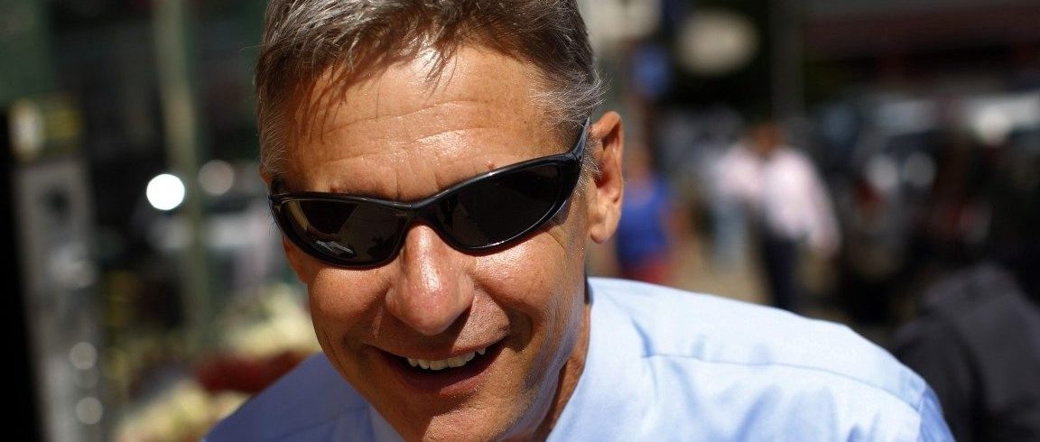 Republican presidential candidate and former New Mexico Governor Gary Johnson walks away from a campaign stop in Concord, New Hampshire, August 23, 2011. REUTERS/Brian Snyder