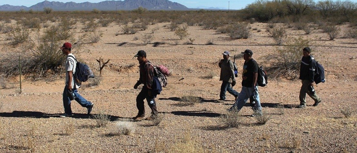 Undocumented Mexican immigrants walk through the Sonoran Desert after illegally crossing the U.S.-Mexico border. (John Moore/Getty Images)