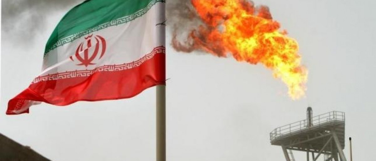 Gas flares from an oil production platform at the Soroush oil fields with an Iranian flag in the foreground in the Persian Gulf, 1,250 km (776 miles) south of the capital Tehran, in a file photo. (Reuters)