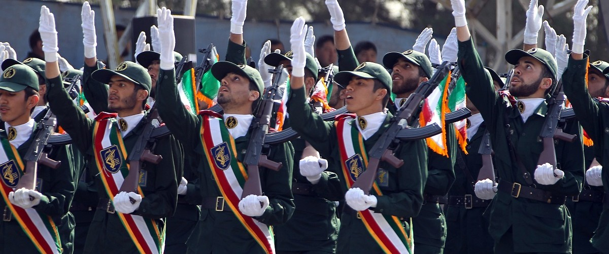 Iranian elite revolutionary guards march during an annual military parade which marks Iran's eight-year war with Iraq, in the capital Tehran on September 22, 2011. Atta Kenare/AFP/Getty Images.