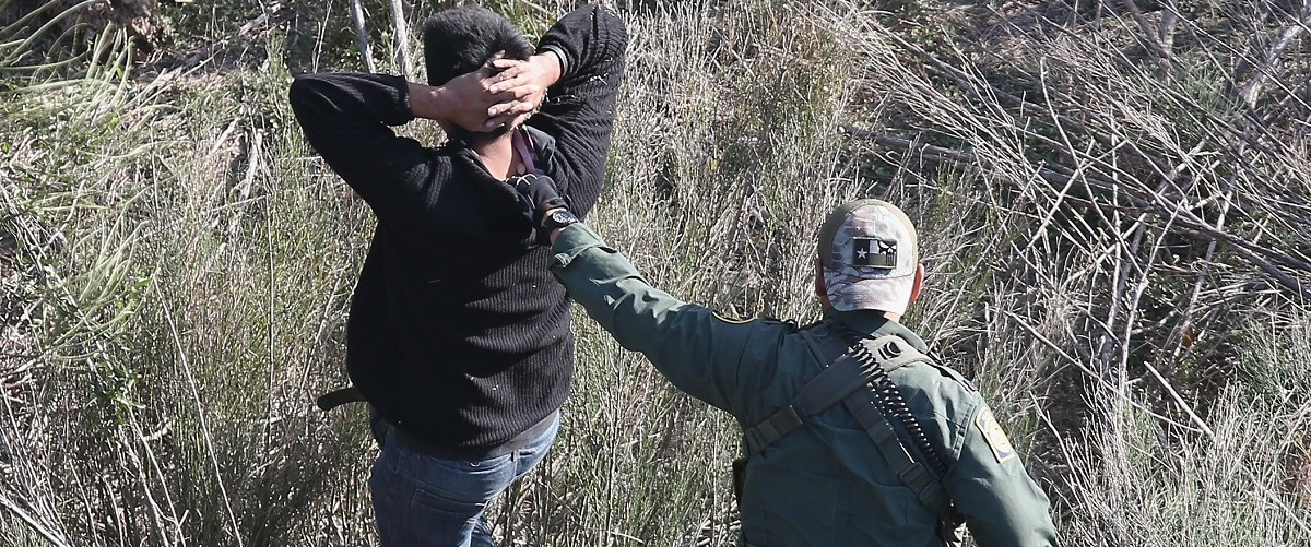A U.S. Customs and Border Protection agent detains undocumented immigrants near the U.S.-Mexico border on December 10, 2015 at La Grulla, Texas. Border security remains a key issue in the U.S. Presidential campaign. John Moore/Getty Images.