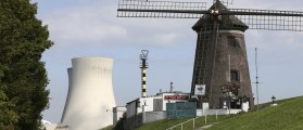 A windmill is seen near the Doel's nuclear plant in northern Belgium August 20, 2014. Two Belgian nuclear reactors owned by GDF-Suez unit Electrabel may remain offline until spring and may need to be halted permanently, Belgian state broadcaster VRT reported on Tuesday. The Belgian nuclear regulator ordered production to be stopped at the 1,008 megawatt Tihange 2 reactor and the 1,006 megawatt Doel 3 reactor in 2012 after finding indications of cracks in their core tanks. Electrabel was not immediately available for comment. REUTERS/Francois Lenoir (BELGIUM - Tags: ENERGY ENVIRONMENT)