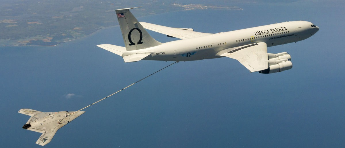 The Navy's unmanned X-47B aircraft receives fuel from an Omega K-707 tanker plane while operating in the Atlantic Test Ranges over the Chesapeake Bay, Maryland April 22, 2015. This test marked the first time an unmanned aircraft refueled in flight. Picture taken on April 22, 2015. REUTERS/Liz Wolter/U.S. Navy photo/Handout