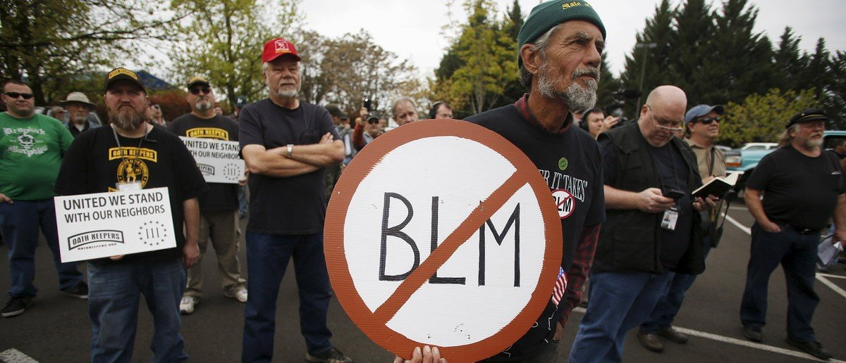 A Sugar Pine Miner supporter holds a anti-BLM sign at a rally outside the Bureau of Land Management's offices in Medford, Oregon April 23, 2015. The owners of the Oregon gold mine who called in armed activists the Oath Keepers to protect their claim amid a bitter land use dispute with the U.S. government have appealed a federal stop-work order, U.S. officials said on Thursday. REUTERS/Jim Urquhart