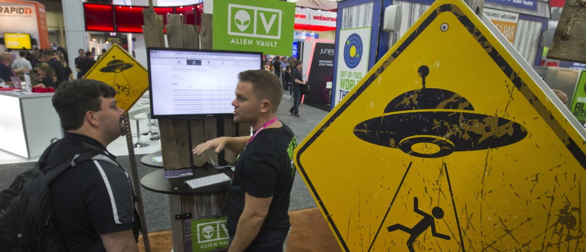 Alien abduction warning signs are posted in the AlienVault booth during the Black Hat USA 2015 cybersecurity conference in Las Vegas, Nevada August 5, 2015. AlienVault makes a unified security management platform for businesses, a representative said. REUTERS/Steve Marcus