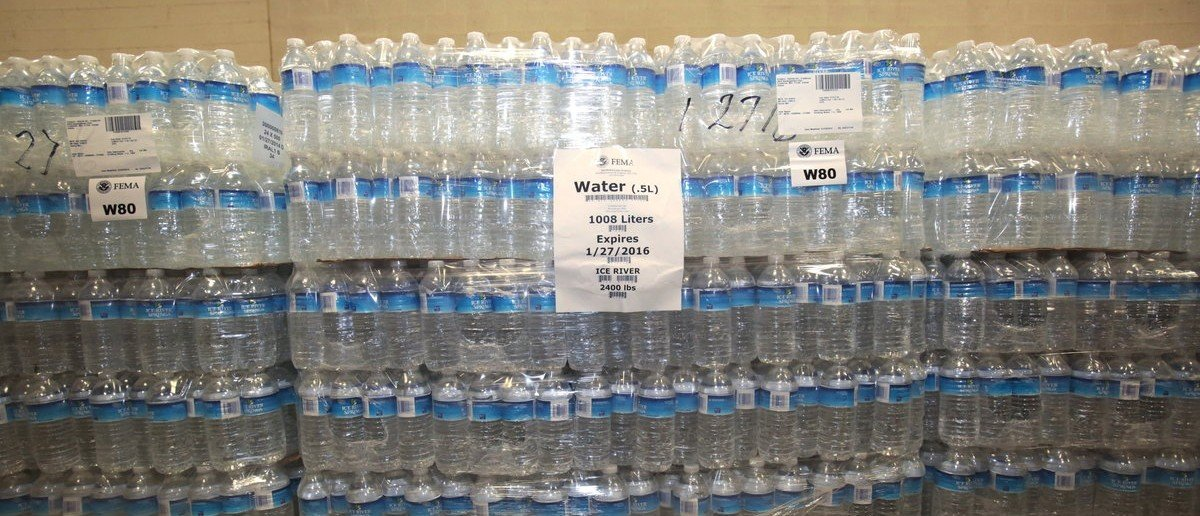 The Food Bank of Eastern Michigan holds stacks of bottled water in the agency's warehouse that will be distributed to the public, after elevated lead levels were found in the city's water, in Flint, Michigan December 16, 2015.     REUTERS/Rebecca Cook