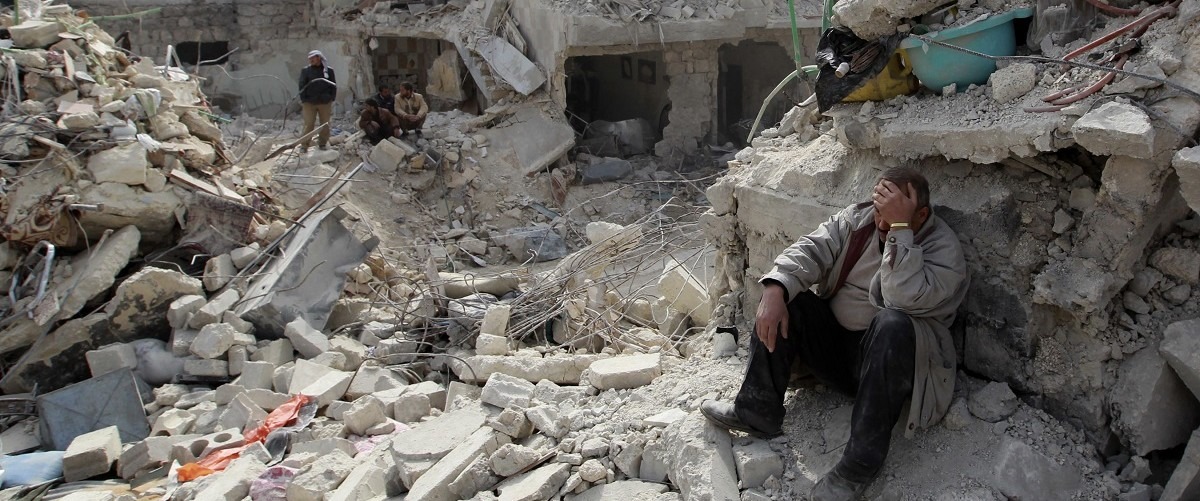 A man at a site recently hit by what activists said was a Scud missile in Aleppo's Ard al-Hamra neighborhood, February 23, 2013. REUTERS/Muzaffar Salman