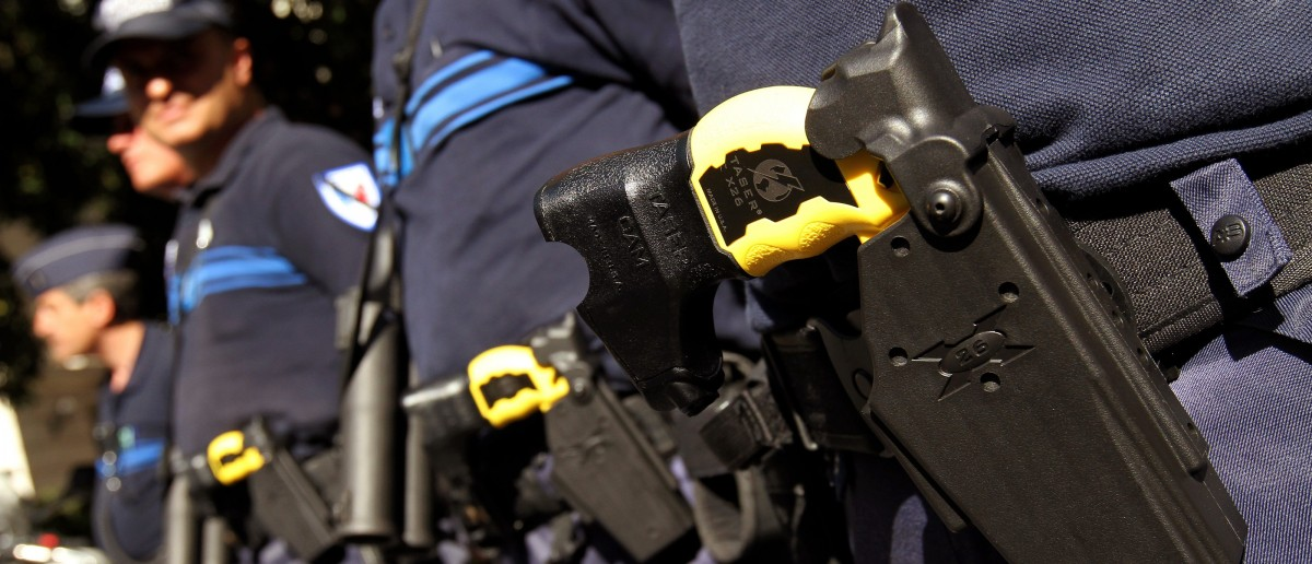 Municipal Police in Nice pose with the Taser X26 model in their holsters during a presentation in Nice, south eastern France May 27, 2010. REUTERS/Sebastien Nogier (FRANCE - Tags: CRIME LAW) - RTR2EFNU