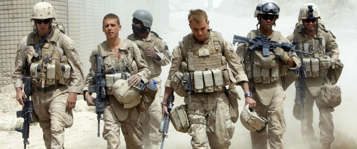 A US Navy Corpsman and US Marines in southern Afghanistan (Reuters/Goran Tomasevic)